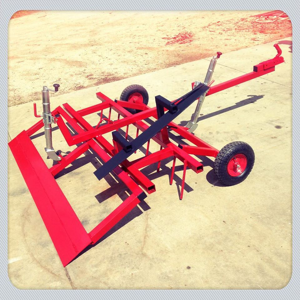 Custom built fully adjustable arena rake groomer by Boss