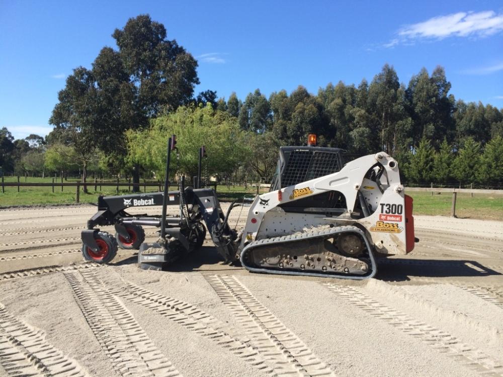 Laser-grading sand horse arena