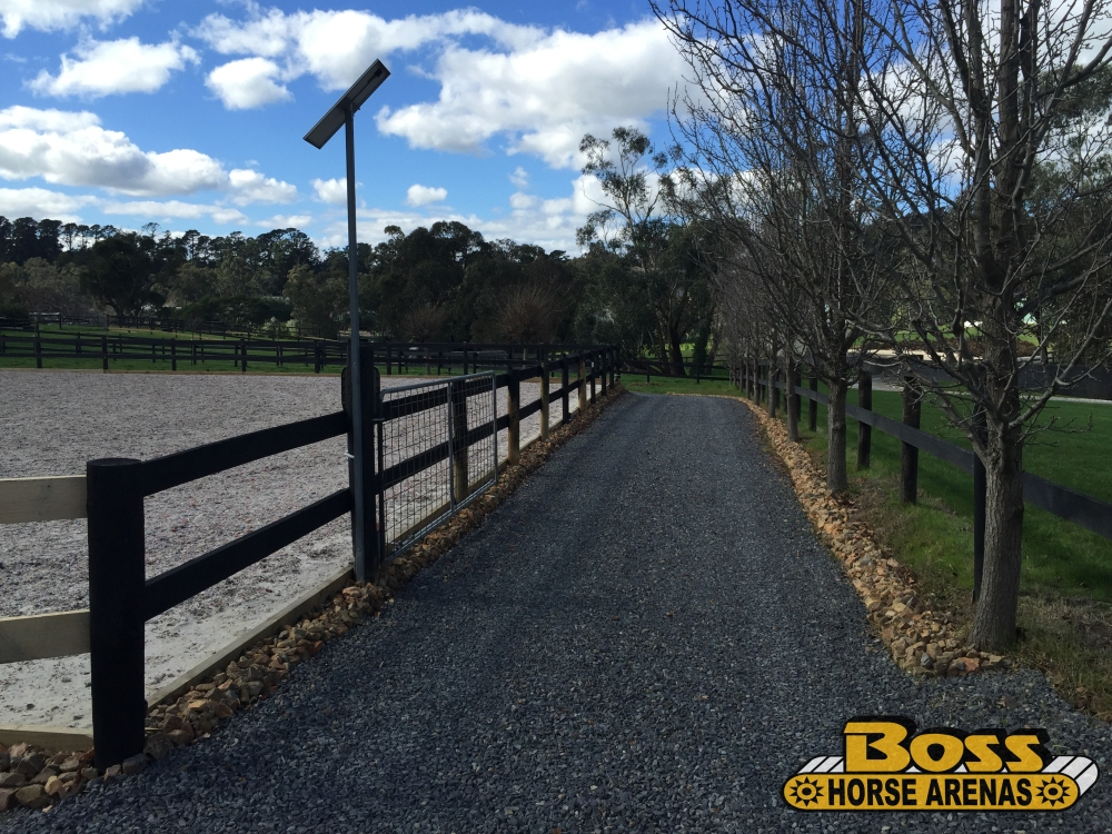Crushed rock driveway and geotextile horse arena