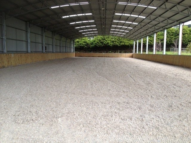 Geotextile indoor horse riding arena
